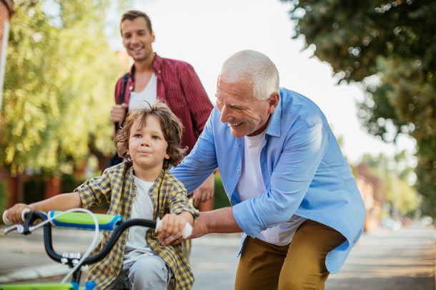 Grandfather with grandson riding a bike